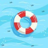 Классический томбуй кольца спасательного жилета с голубой морской водой на предпосылке Стоковое Изображение