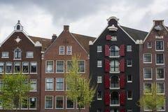 4 классических голландских дома под облачным небом Стоковые Изображения RF