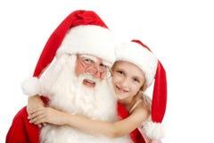 Классическое Санта и счастливая маленькая девочка Стоковая Фотография