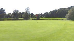 класть зеленого цвета гольфа Стоковые Изображения