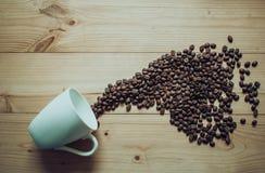 Класть чашку с фасолями Стоковое Фото