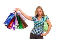 кладет белокурую женщину в мешки покупкы Стоковая Фотография RF