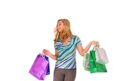 кладет белокурую женщину в мешки покупкы Стоковая Фотография