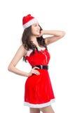 кладет женщину в мешки santa Девушка красоты азиатская модельная в шляпе Санты изолировала o Стоковое Фото