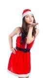 кладет женщину в мешки santa Девушка красоты азиатская модельная в isolat костюма Санты Стоковые Фотографии RF