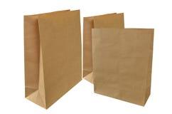 кладет коричневую бумагу в мешки 3 Стоковое Изображение RF