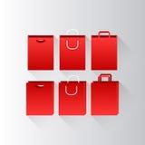кладет красную покупку в мешки Стоковая Фотография RF