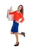 кладет покупку в мешки sally девушки Стоковая Фотография
