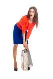 кладет покупку в мешки sally девушки Стоковая Фотография RF