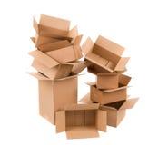 кладет раскрытый картон в коробку Стоковое Изображение RF