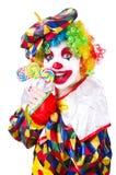 Клоун с леденцами на палочке Стоковые Фото