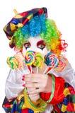 Клоун с леденцами на палочке Стоковые Изображения
