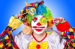 Клоун с леденцами на палочке Стоковое фото RF