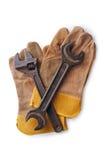 2 ключа на защитных перчатках на белой предпосылке Стоковое фото RF