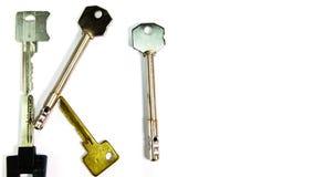 ` Ключа ` слова сделано ключей различной формы, на белой предпосылке Промежуток времени акции видеоматериалы
