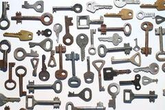 Ключи на белой предпосылке стоковая фотография rf