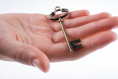 Ключ в руке Стоковая Фотография