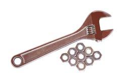 Ключ и гайки на белизне Стоковые Изображения RF