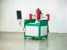 лазер резца промышленный Запрограммированная голова робота стоковое изображение rf