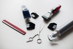 Лаки для волос, клиперы, гребень и ножницы дизайна Стоковая Фотография