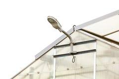 Лампа на прозрачном парнике, белом небе Стоковое Фото