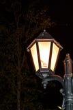 Лампа против темной предпосылки Стоковое Изображение