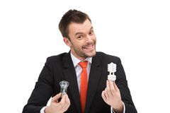 Лампа Eco в руке бизнесмена Стоковые Фото