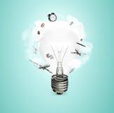 Лампочка с значками Стоковое Изображение RF