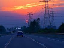 Ландшафт захода солнца шоссе на пути стоковые изображения rf