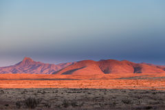 Ландшафт Неш-Мексико США пустыни захода солнца светлый высокий Стоковое Изображение