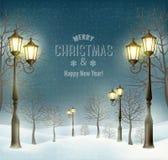 Ландшафт зимы вечера рождества с фонарными столбами Стоковые Фото