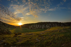 Ландшафт на заходе солнца/восходе солнца Стоковые Фото
