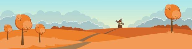 Ландшафт осени с мельницей и холмами Стоковое фото RF