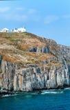 Ландшафт с старыми маяком и морем Стоковое Фото