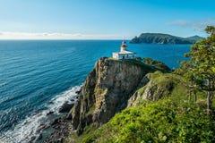 Ландшафт с старыми маяком и морем Стоковые Изображения