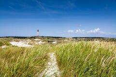 Ландшафт дюны с маяком на Северном море Стоковые Изображения