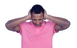 Латинские люди покрывая его уши стоковое изображение