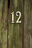 Латунный 12 на двери Стоковое Фото