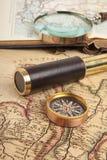 Латунный телескоп на карте Стоковое Фото