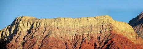 Ла pollera de Ла coya, красная гора на заходе солнца Стоковая Фотография RF