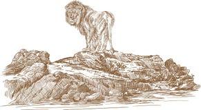 Лев и утесы Стоковая Фотография