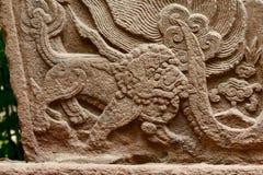 Лев на железной стене Стоковые Изображения