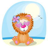 Лев на пляже Стоковая Фотография