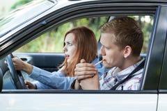 Легкомысленный водитель в автомобиле Стоковое фото RF