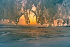 Лед выдалбливанный с предпосылкой захода солнца Стоковые Изображения RF