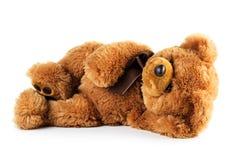 Лежать плюшевого медвежонка игрушки Стоковая Фотография RF