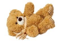 Лежать плюшевого медвежонка стоковое фото rf