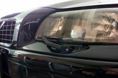Лезвие счищателя фары автомобиля стоковая фотография