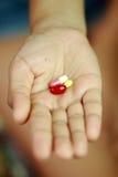 Лекарства на руках Стоковые Фото