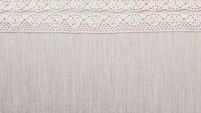 Лента шнурка на предпосылке linen ткани Стоковые Изображения RF